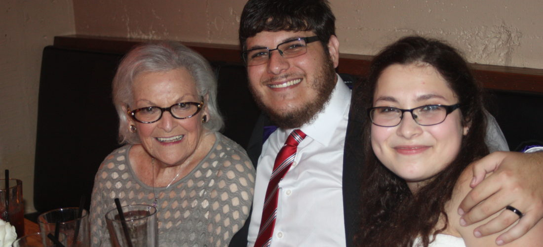 Harris with his wife and grandmother at his wedding.